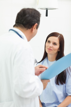 Doctor talking with a patient in an examination room Stock Photo - 16202721