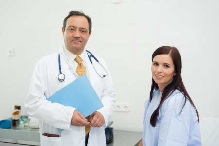 Patient and doctor together in an examination photo