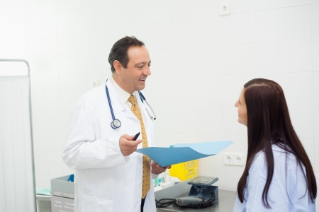 Doctor and patient talking together in an examination room Stock Photo - 16202684