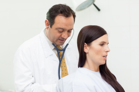 Patient being auscultated by a doctor in an examination room Stock Photo - 16202872