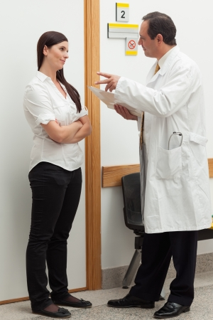 Doctor talking to a patient in a hallway photo