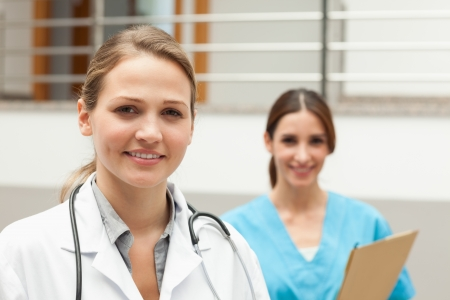 Nurse and a doctor standing in a hospital reception Stock Photo - 16204620