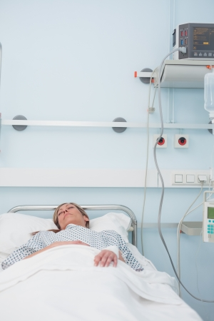 Female patient sleeping on a medical bed in hospital ward Stock Photo - 16203466