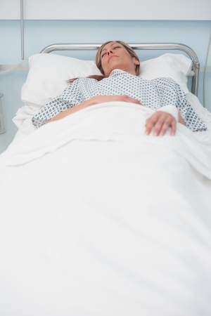 Woman sleeping on a bed in hospital ward Stock Photo - 16202217