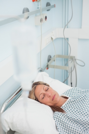 Woman lying on a medical bed while closing her eyes in hospital ward Stock Photo - 16203788