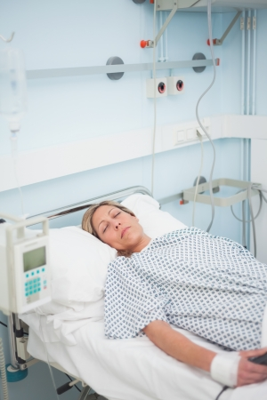 Female patient lying on a medical bed with closed eyes in hospital ward Stock Photo - 16204188