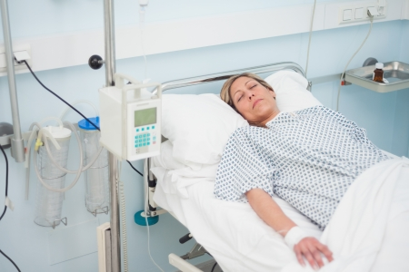 Woman lying on a medical bed with closed eyes in hospital ward Stock Photo - 16202529