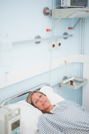 Woman lying on a bed while smiling in hospital ward Stock Photo - 16203680