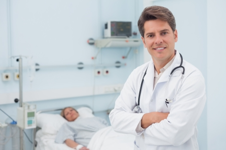 Doctor smiling with crossed arms in hospital ward Stock Photo - 16203919