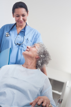 Elderly patient in a wheelchair in hospital ward Stock Photo - 16204449