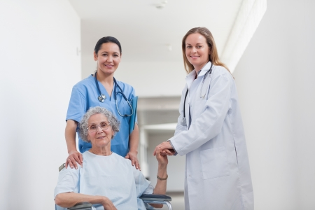 Patient in corridor holding hand of a doctor in hospital ward Stock Photo - 16203865