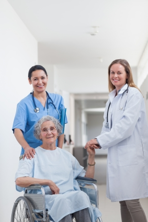Doctor next to a patient on wheelchair in hospital ward Stock Photo - 16204306
