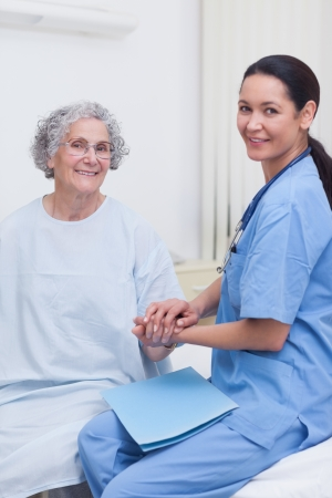 Nurse holding hand of a patient in hospital ward Stock Photo - 16204418