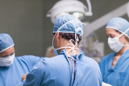 Medical team working in operating theater photo