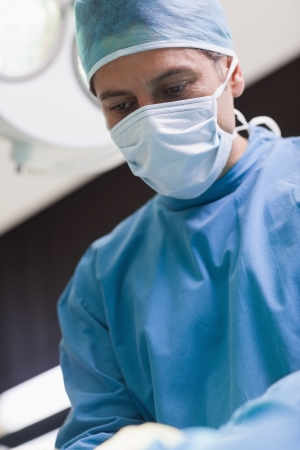 Doctor looking at a patient in operating theater photo