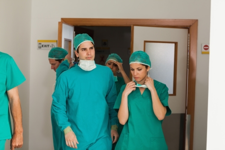 Surgery team leaving the operating room in hospital Stock Photo - 16208581