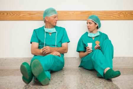 having a break: Surgeons having a break in the corridor in a hospital