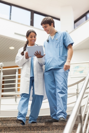 Doctor and nurse in the stairs in hospital Stock Photo - 16207395