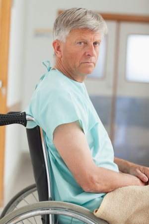Close up of a man in a wheelchair in hospital  photo