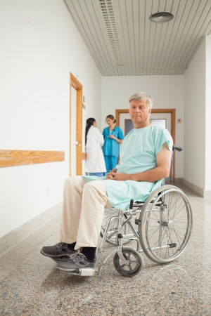 Male patient in a wheelchair in hospital photo