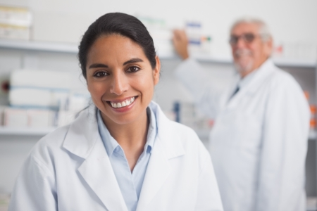 Smiling pharmacist looking at camera in hospital