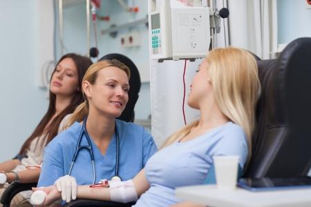 Nurse talking to a patient in hospital ward photo