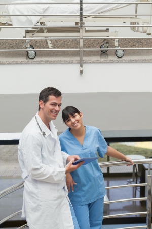 Doctor holding a tablet computer next to a nurse in hospital ward Stock Photo - 16207032