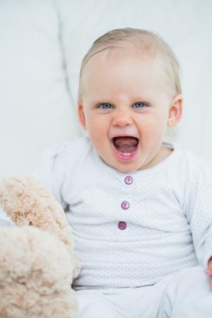 shrieking: baby shrieking in living room Stock Photo