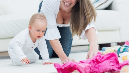 Baby and a mother on all fours in living room Stock Photo - 16202547