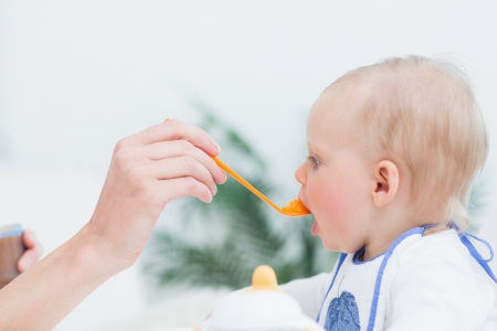 Baby eating in living room Stock Photo - 16203134
