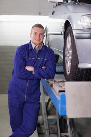 gudgeon: Man standing next to a car in a garage
