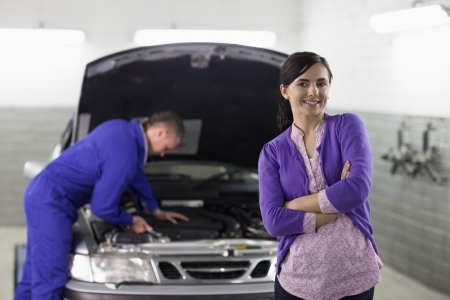 gudgeon: Front view of a client looking at camera in a garage
