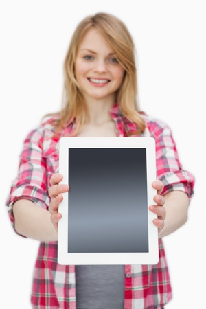 scrolling: Woman showing a tablet computer at camera against a white background