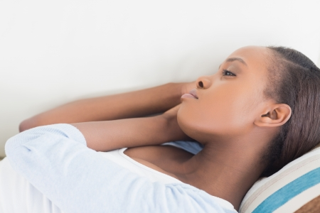 solicitous: Black woman lying on back in a living room