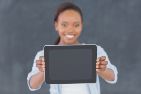 Focus on a tablet computer in a classroom photo