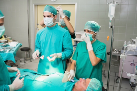 Nurse attaching the surgeon mask in an operating theatre Stock Photo - 16229049