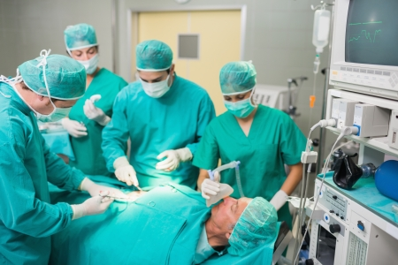 Medical team operating in an operating theatre photo