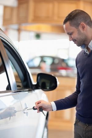 Man inserting a car key in a car Stock Photo - 18095388