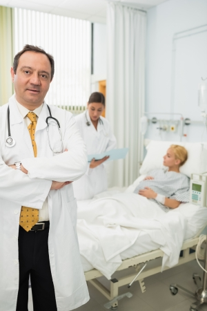 Doctor folding his arms in maternity ward photo