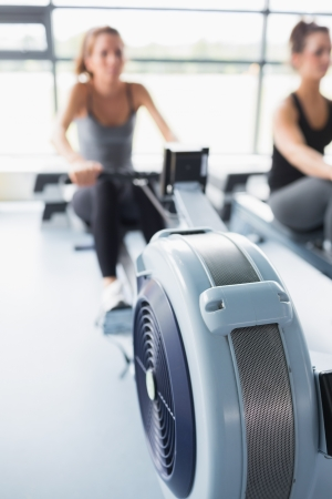 Rowing machine being used by woman in gym photo