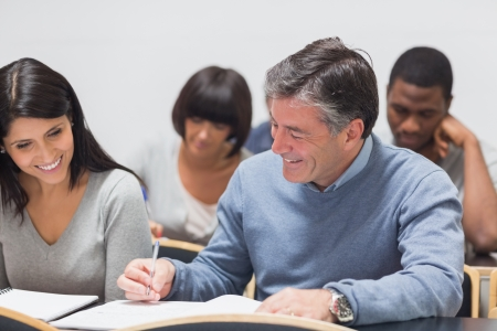 adult education: Man and woman takling during lecture in college