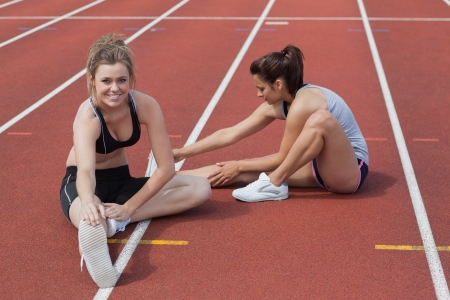 Women are stretching on the running track photo