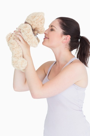 Woman in pyjamas with her teddy bear photo