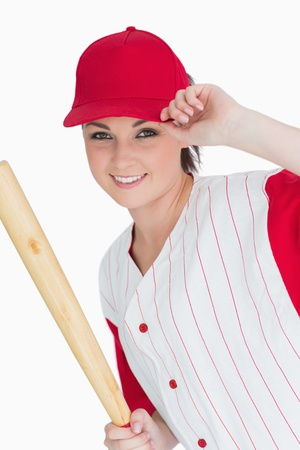 Smiling woman holding a baseball bat against white background photo