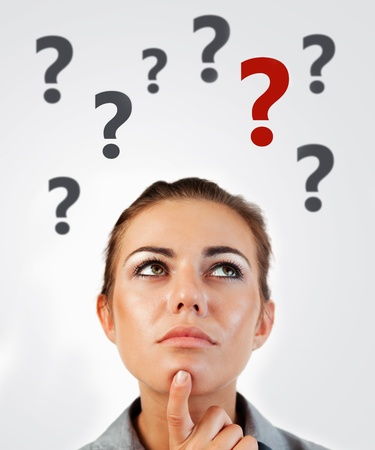 Woman thinking with question marks abover head on white background
