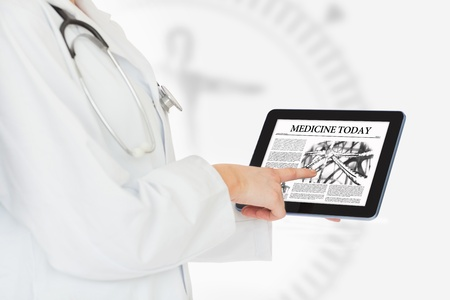 Doctor reading medicine today from digital tablet  photo