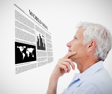 world news: Man reading holographic world news against white background