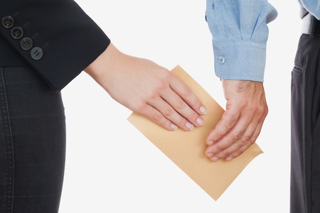 Close-up of business people holding an envelope over white background photo