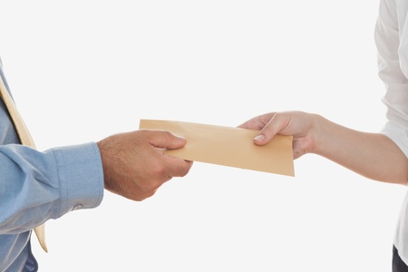 Close-up of business people holding envelope over white background Stock Photo - 18123067