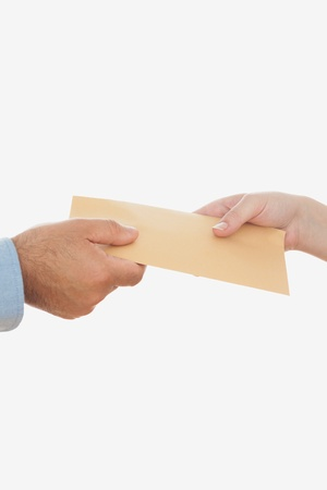 Close-up of business people holding envelope against white background Stock Photo - 18122938